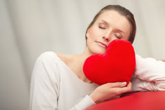 Sleeping Woman in love with heart - portrait of your girl. Sleeping woman in love with red heart - portrait of your girl Royalty Free Stock Photography
