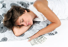 Sleeping woman with money Royalty Free Stock Image