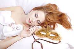 Sleeping woman near carnival mask. Stock Images