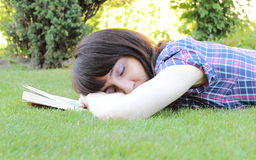 Sleeping woman after reading a book Stock Photos