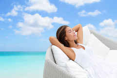 Sleeping woman relaxing lounging on a outdoor sofa Royalty Free Stock Image
