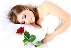 Sleeping woman with rose Royalty Free Stock Photography