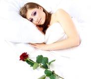 Sleeping woman with rose Stock Photos