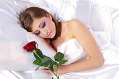 Sleeping woman with rose Royalty Free Stock Images