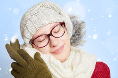 Sleeping woman in the snow in winter. Sleeping young woman in the snow in winter wearing winter clothing Stock Photos