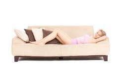 Sleeping woman on sofa stock photos