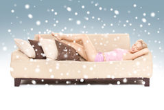 Sleeping woman on sofa with snow Royalty Free Stock Images