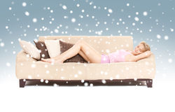 Sleeping woman on sofa with snow Stock Photo