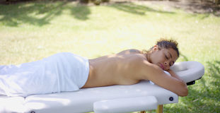 Sleeping woman in towel laying on massage table Royalty Free Stock Photos