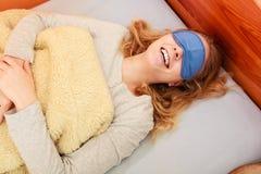 Sleeping woman wearing blindfold sleep mask. Royalty Free Stock Photos