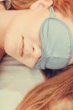 Sleeping woman wearing blindfold sleep mask. Stock Images