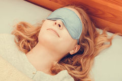 Sleeping woman wearing blindfold sleep mask. Royalty Free Stock Image