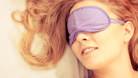 Sleeping woman wearing blindfold sleep mask. Tired woman sleeping in bed wearing blindfold sleep mask. Young girl taking nap. Instagram filtered Royalty Free Stock Photography
