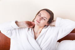 Sleeping woman in white bathrobe Royalty Free Stock Image