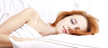 Sleeping woman in whitelying in the bed Stock Image