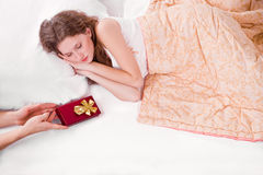 Sleeping Woman With Gift Royalty Free Stock Images