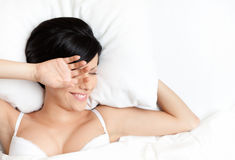 Sleeping woman in the wonderful bed Stock Photography