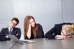Sleeping at work. Group of businesspeople sleeping at work Royalty Free Stock Photo