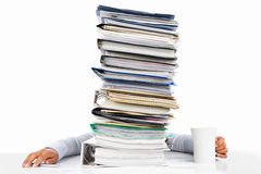 Sleeping worker behing high pile of paperwork Stock Photo