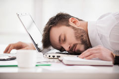Sleeping at working place. Royalty Free Stock Images