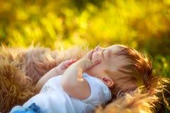 Sleeping yawning shaggy baby boy, close-up, summer Royalty Free Stock Photos
