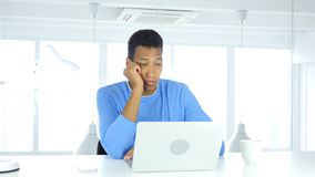Sleeping Young Afro-American Man Sitting At Work stock photography
