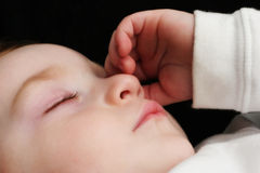 Sleeping young boy Stock Images