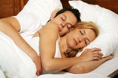 Sleeping young couple Stock Images