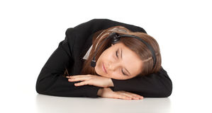 Sleeping young customer service operator girl Stock Images