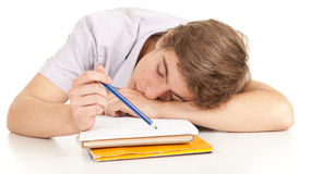 Sleeping young male student with books Stock Images