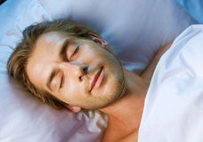 Sleeping Young Man. Happy Young Man Sleeping in his Bed Stock Photos