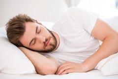 Sleeping young man Stock Photo