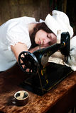 The sleeping young seamstress Royalty Free Stock Image