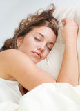 Sleeping young woman Stock Photo