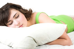 Sleeping young woman Stock Images