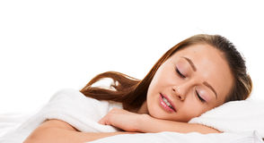 Sleeping young woman in bed on pillow Stock Image