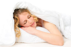 Sleeping young woman covered with blanket Royalty Free Stock Photo