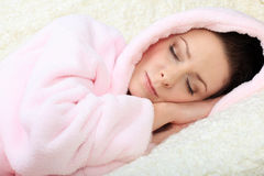 Sleeping young woman having her eyes closed Stock Image