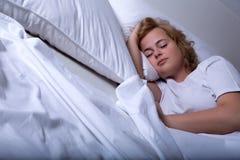 Sleeping young woman Stock Photography