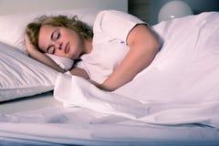 Sleeping young woman Stock Photo