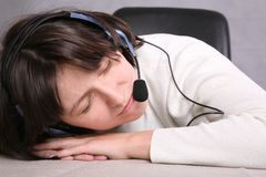 Sleepingg call service agent Stock Images