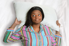 Sleepless African American Woman. Resting head on pillow royalty free stock photos