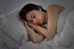 Sleepless Insomnia Young Woman. Worried Young Woman with Insomna laying in the bed Royalty Free Stock Photos
