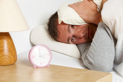 Sleepless man. Sleepless night. Man in bed suffering from insomnia royalty free stock photo