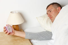 Sleepless man. Sleepless night. Man in bed suffering from insomnia royalty free stock photos