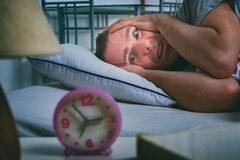 Sleepless Man In Bed Stock Images