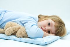 Sleepless night. Little, sleepless, girl lying in bed with teddy bear stock photography