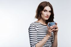 Beautiful auburn-haired woman holding a cup of coffee Royalty Free Stock Image