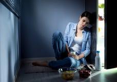 Sleepless woman having a glass of milk Stock Image