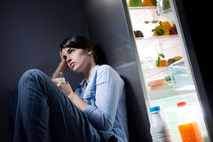 Sleepless woman having a glass of milk Stock Photo